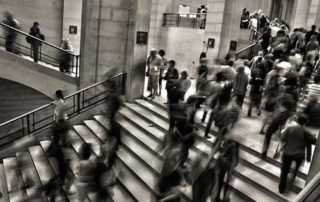 Black and white timelapse image of people walking on stairs