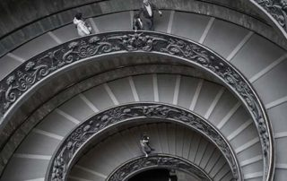 Downward perspective view of spiraling staircase